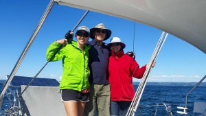 Ken, Mom and I sailing aboard Dos Momentos